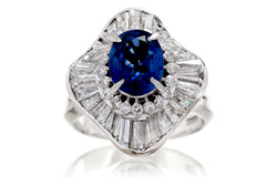 Woman vintage style sapphire engagement ring with diamond ballerina baguettes