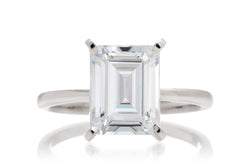 Woman Emerald Solitaire Moissanite Engagement Ring | The Adeline