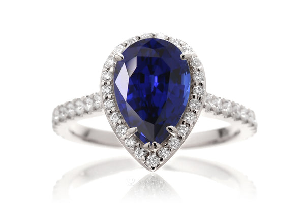 Woman Sapphire Engagement Ring | Pear Shape Diamond Halo | The Sunset