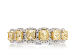 The Penelope six cushion yellow diamond wedding band