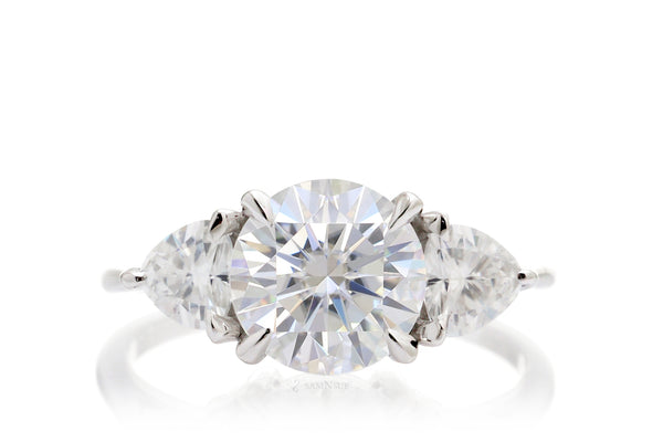 The Trillion Threestone Moissanite Engagement Anniversary Ring
