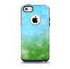 The Abstract Shaped Sparkle Unfocused Blue & Green Skin for the iPhone 5c OtterBox Commuter Case
