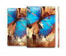 The Bright Blue Butterfly on Grunge Gold Surface Full Body Skin Set for the Apple iPad Mini 3
