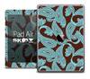 The Brown and Turquoise Paisley Pattern Skin for the iPad Air
