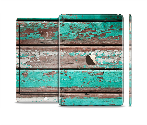 The Chipped Teal Paint On Wood Skin Set for the Apple iPad Pro