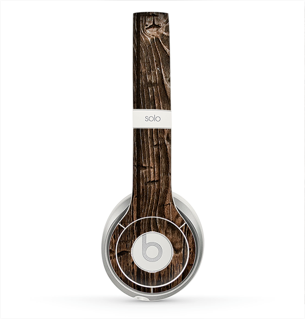 The Rough Textured Dark Wooden Planks Skin for the Beats by Dre Solo 2 Headphones