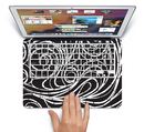 "The Vector White and Black Segmented Swirls Skin Set for the Apple MacBook Pro 15"" with Retina Display"