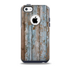 The Wood Planks with Peeled Blue Paint Skin for the iPhone 5c OtterBox Commuter Case