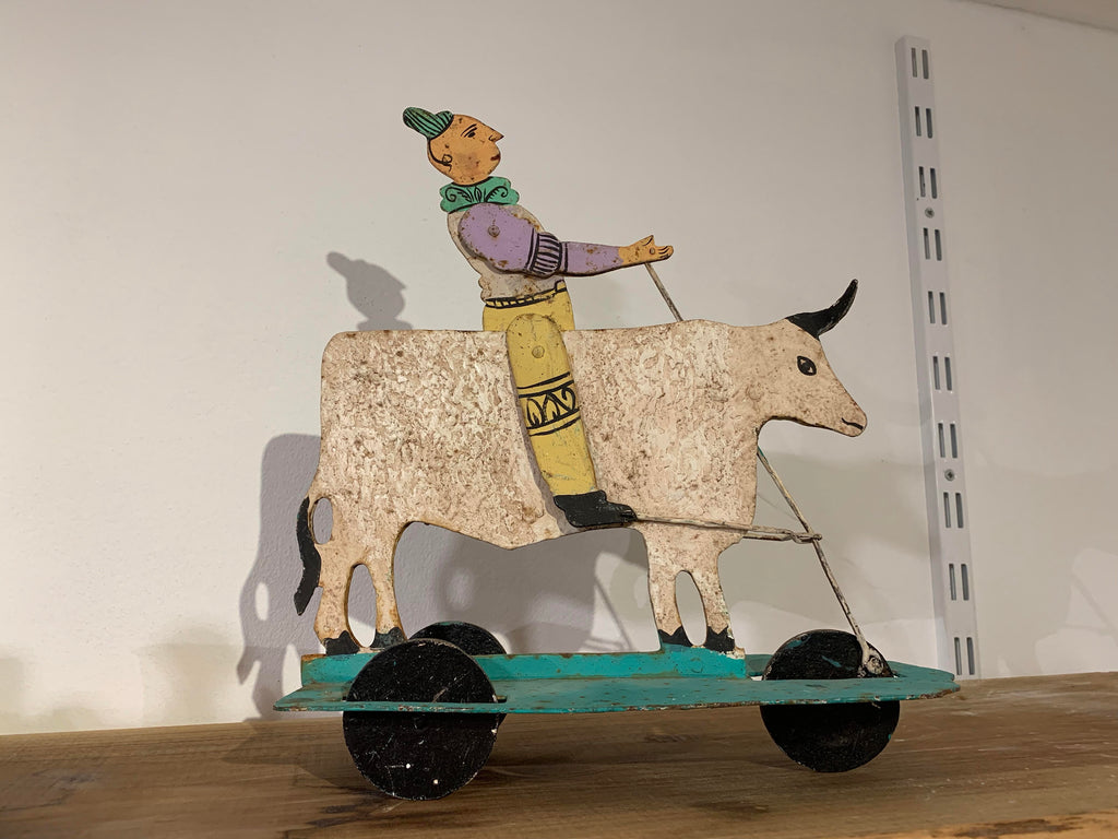 Vintage toy Clown on a cow