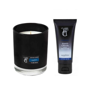 Sapphire set from the CLARRI HILL gift range, comprising of luxurious sapphire hand cream with shea butter, and a sapphire-scented soy candle.