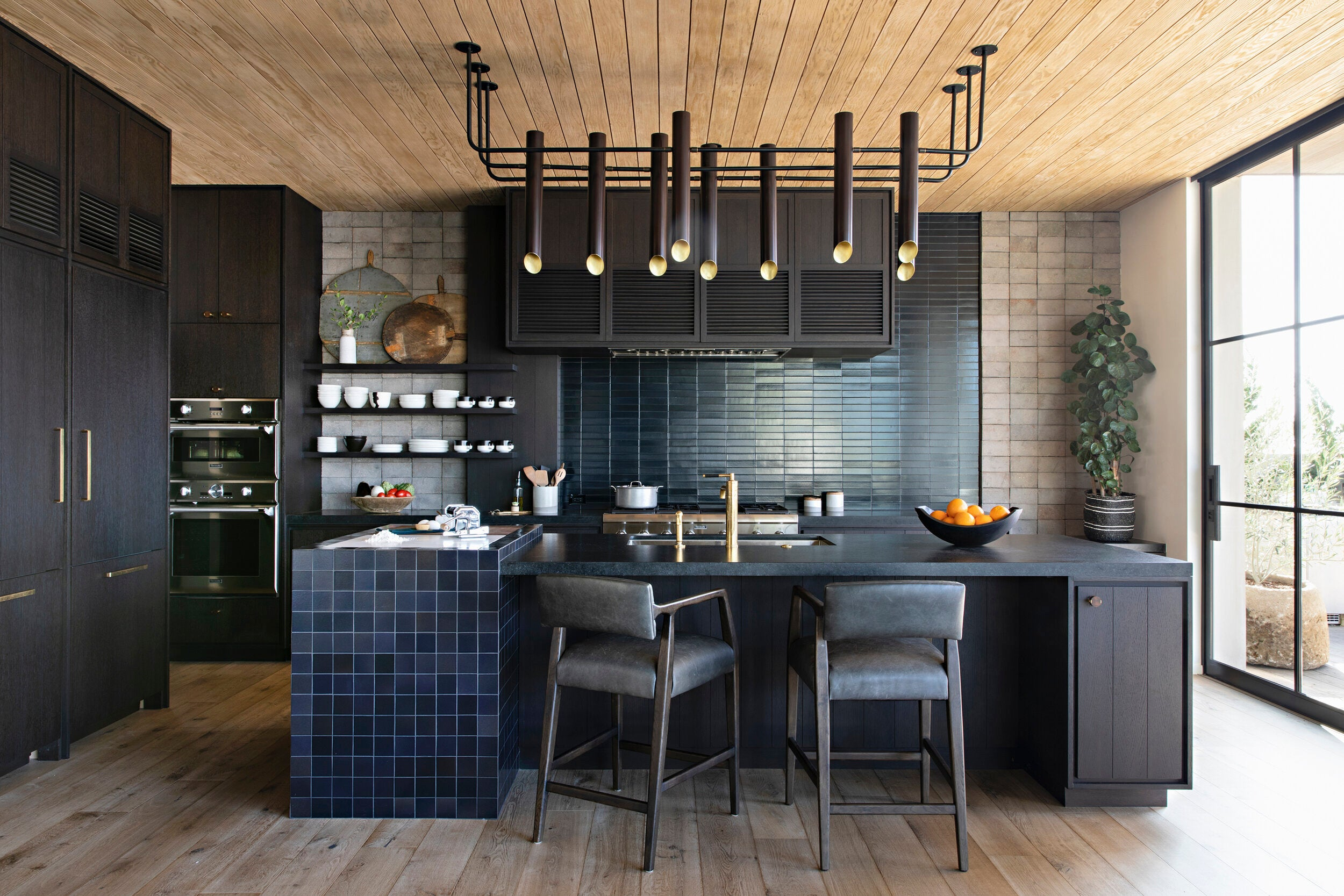 kitchen with tile and wood ceiling
