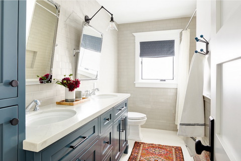 kids bath with subway tile and blue vanity
