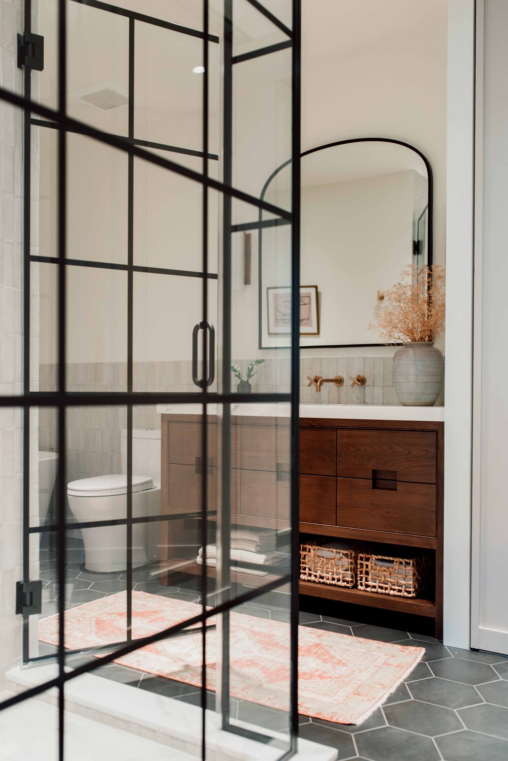 bath with wood vanity and steel shower