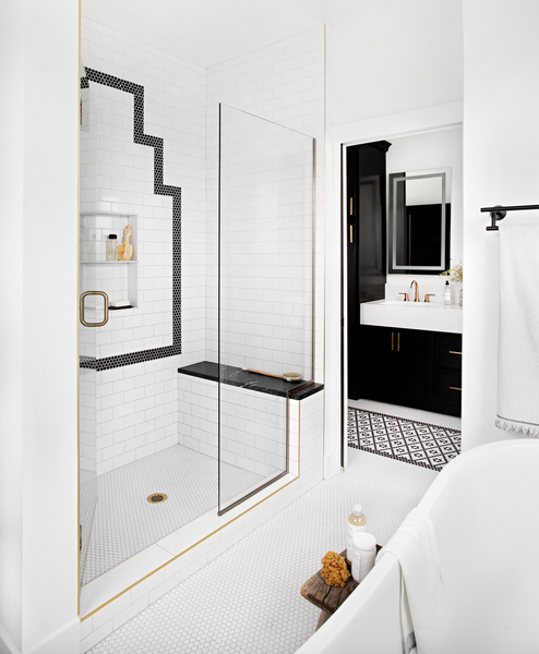 shower with subway and penny tile