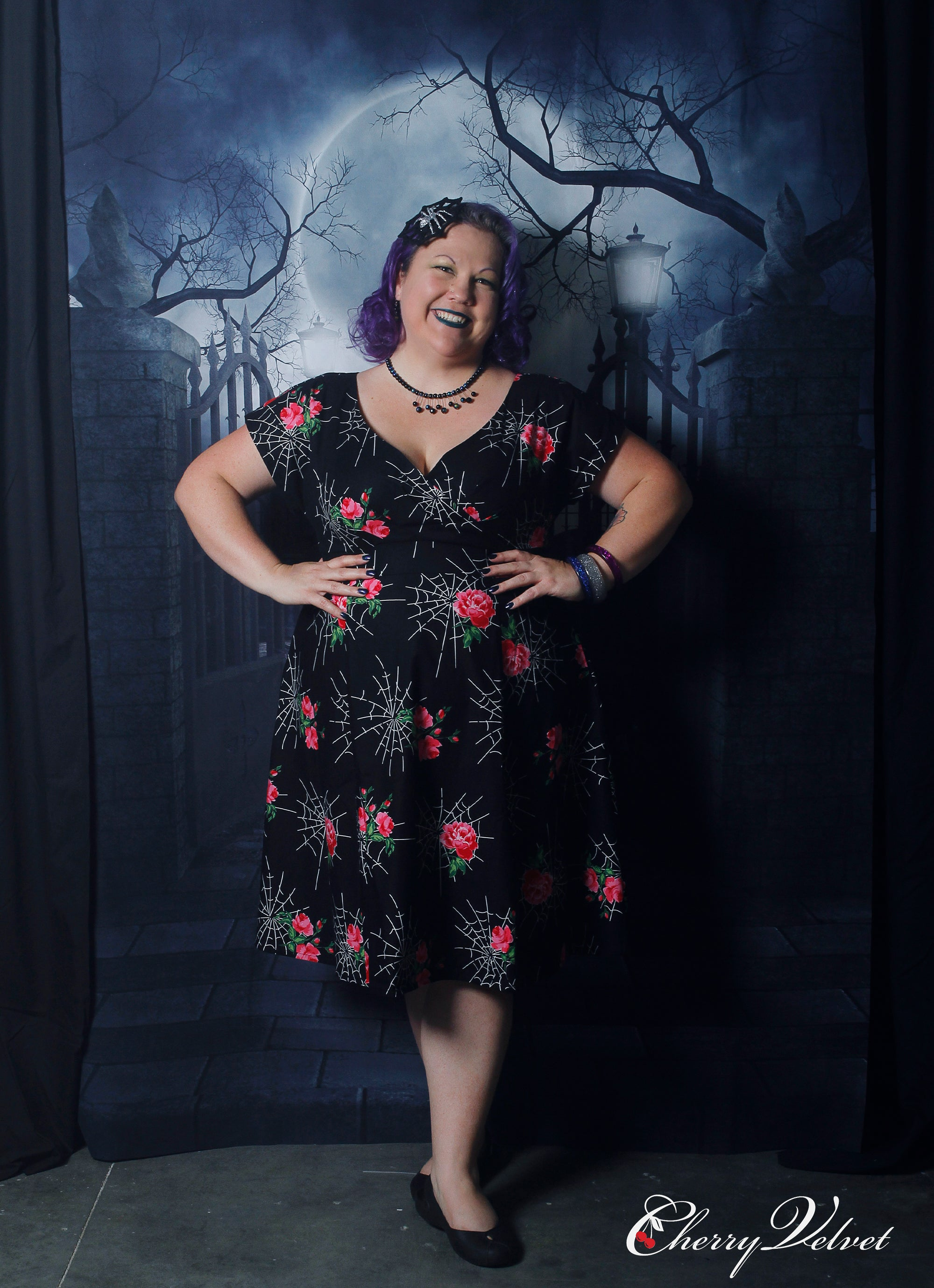 Customer in Cherry Velvet dress at Halloween is Brewing event