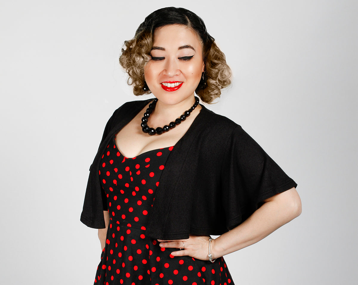 Claire capelet, Doris dress in Black and Red Polka Dot, and Dark Mirror Ball necklace and earring set