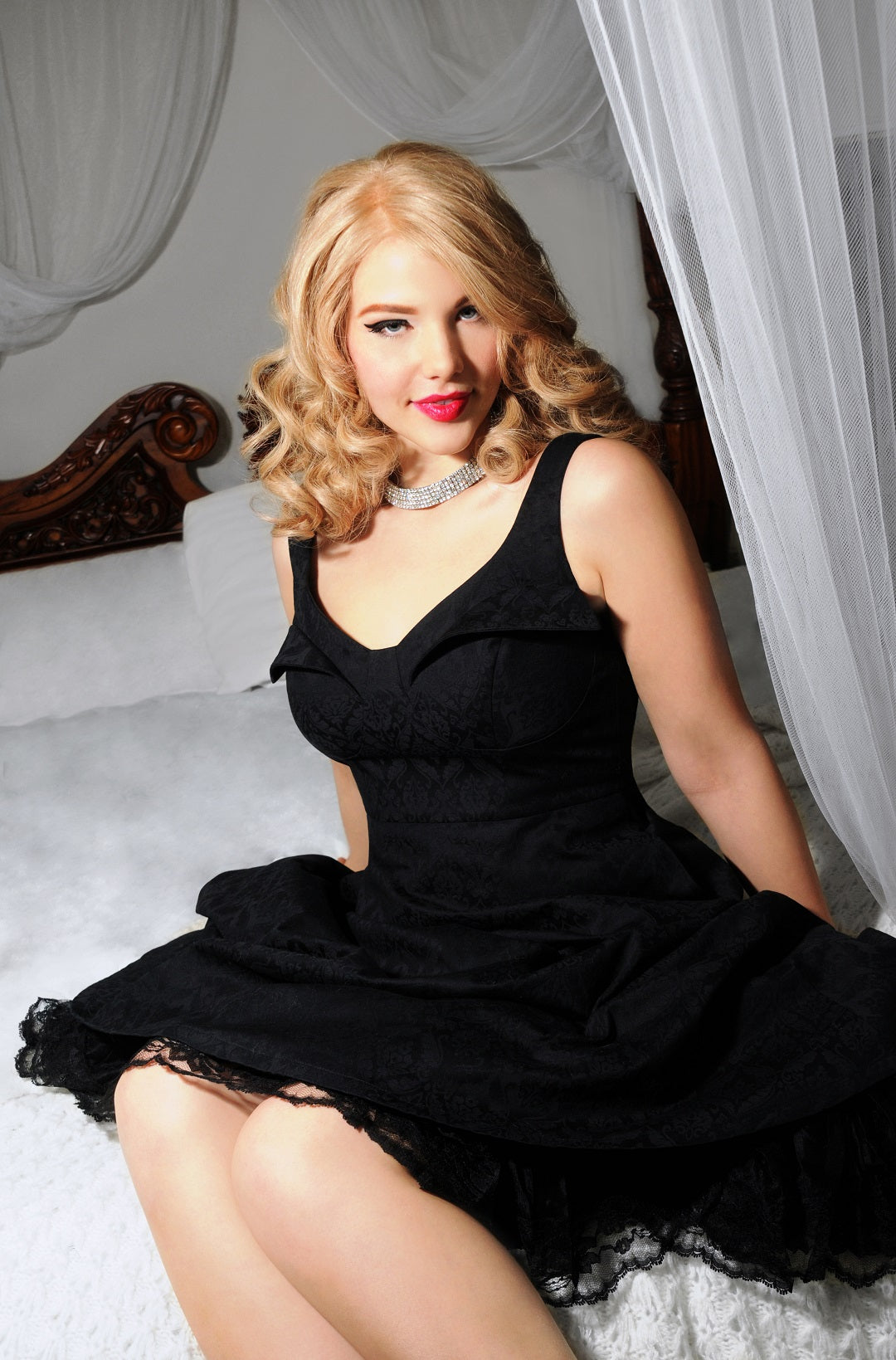 Elly Mayday modelling the Cherry Velvet dress that was named for her, the Elly