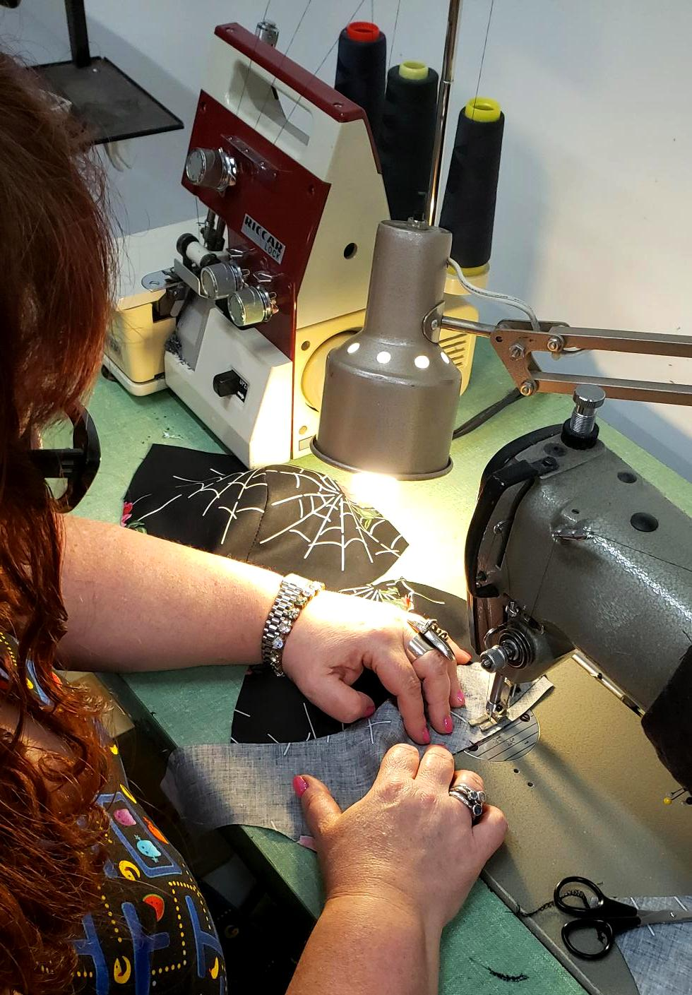 Cherry Velvet's designer Diane Kennedy sewing