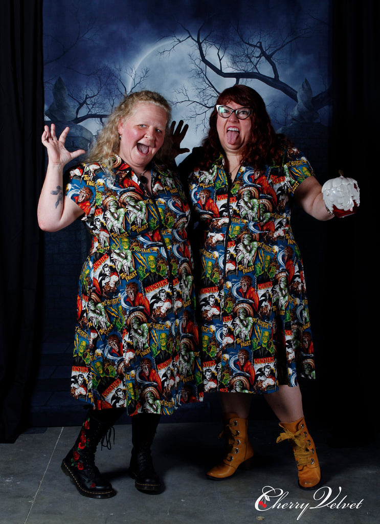 Diane Kennedy and friend in The Horror print Marie dresses at Cherry Velvet's Halloween is Brewing event