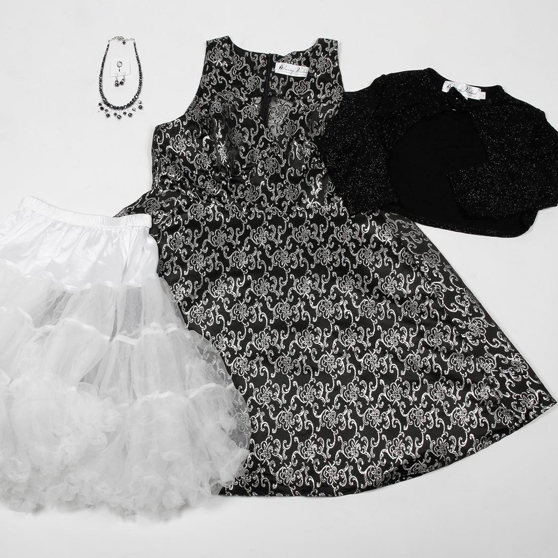 Norma Silver Filigree dress, white chiffon crinoline, Samantha shrug in black sparkle