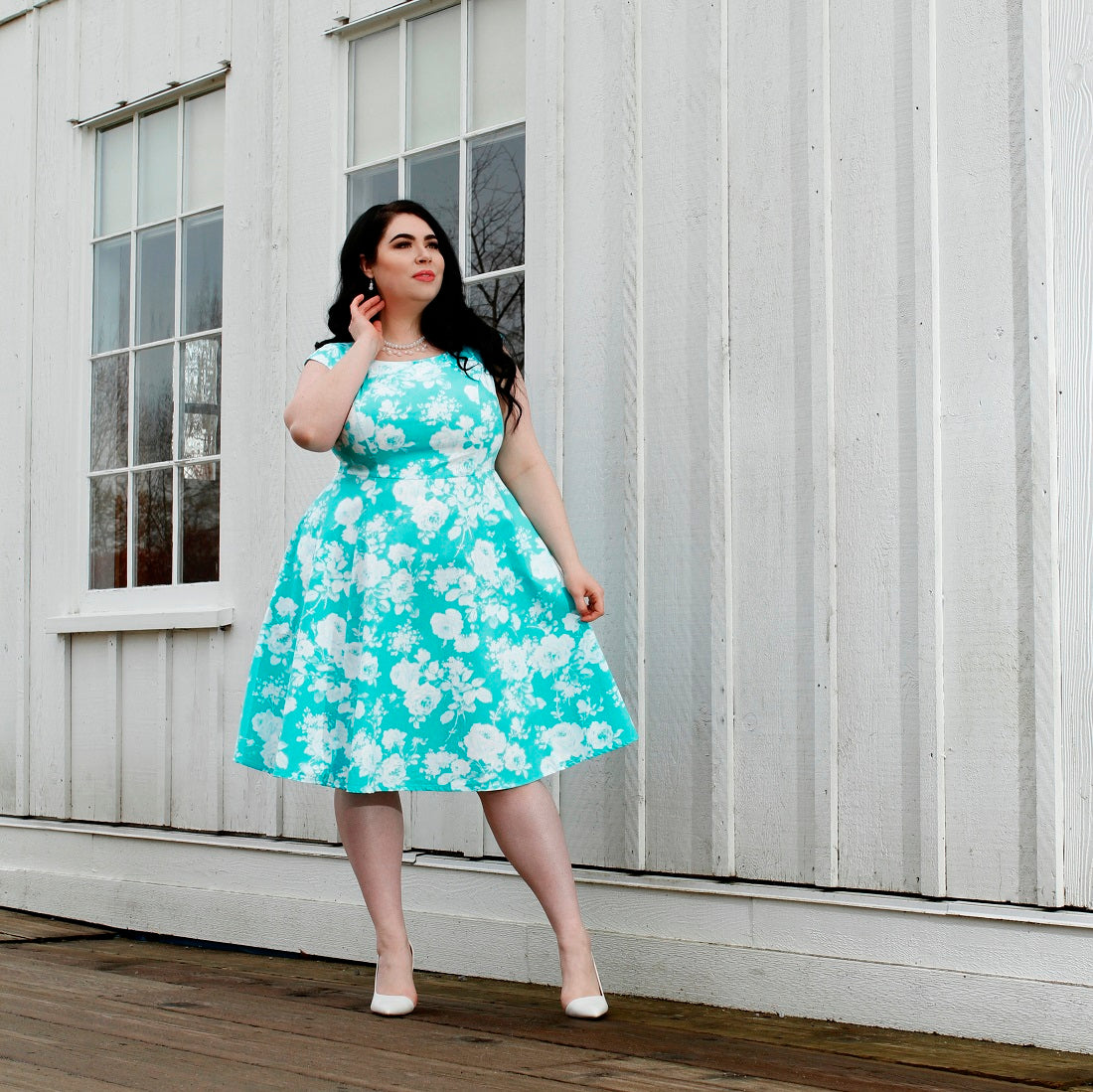 Model Veronica Belle wears the Cherry Velvet Olivia Dress in Aqua Bouquet
