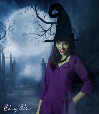 Julia dressed as green witch in purple Cherry Velvet dress