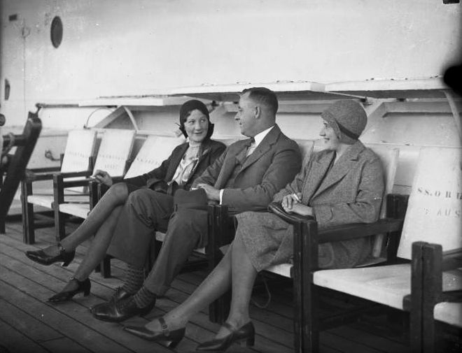 Women and man on ship in the 20s wearing cloche hats