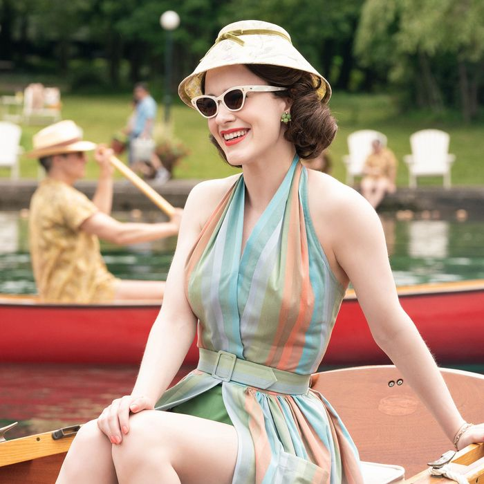 Marlesous Mrs. Maisel wearing a striped sundress