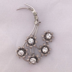 Charmingly curvy 1960s diamanté / rhinestone flower brooch set in detailed metal work
