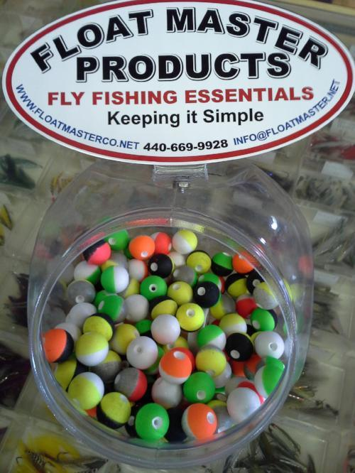 container of small round brightly colored styrofoam strike indicators used in fly fishing with nymph flies