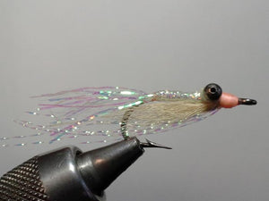 bonefishing fly of pearl flash, heavy eyes and pink head