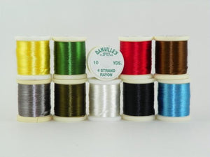 variety of colors of shiny 4 strand floss used for tying bodies of streamer flies from Rangeley maine fly shop