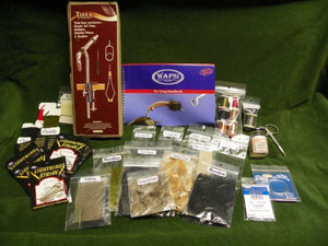 contents of a Wapsi beginners fly tying kit including vise, tools, hooks, thread, chenille, wire, feathers and more
