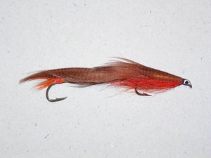 tandem trolling fly with orange underneath and brown wing tied by Ken Grimes for the Rangeley Region Sport Shop
