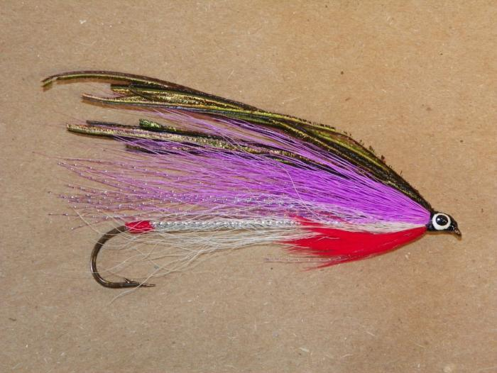 a #2 8XL streamer fly for fly fishing with a red tag and throat and white, lavendar, and peacock wings