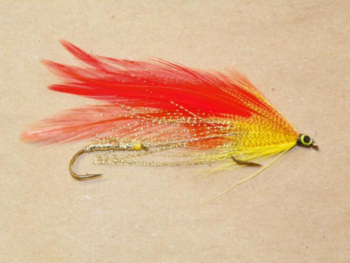 Bright orange and yellow tandem trolling streamer with Krystal Flash along the sides tied by Fishing Favorites in New Hampshire