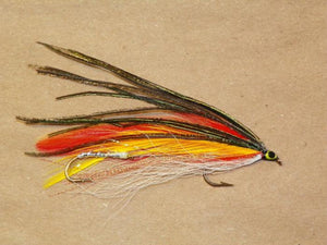 tandem trolling fly with orange and yellow wings topped with peacock and white bucktail underwing tied by Ken Grimes of Fishing Favorites