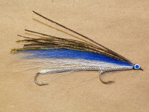 The blue smelt tandem trolling fly topped with peacock herl