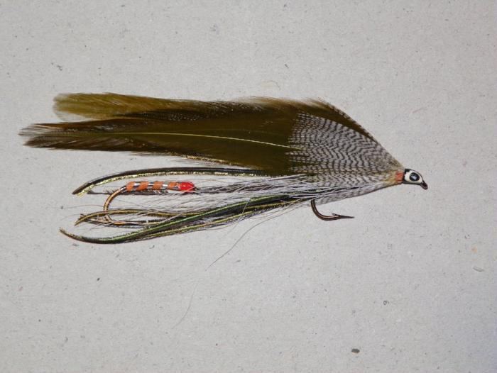 tandem trolling fly patterned after the gray ghost with olive green wing feathers from Rangeley Maine Fly Shop