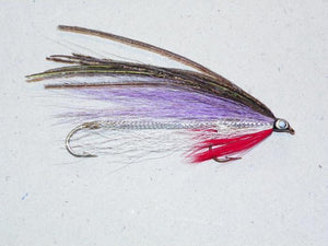 Governor Aiken tandem trolling fly white and purple wings topped with peacock, red throat