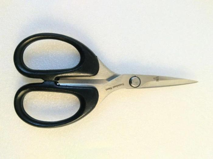 "black handled Dr. Slick synthetics 5"" scissors  Designed for cutting heavy natural and synthetic materials with Heavy blades with large serrations"