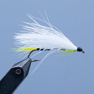 The Black Ghost, a black, yellow, and white streamer fly tied in a Rangeley Maine fly shop