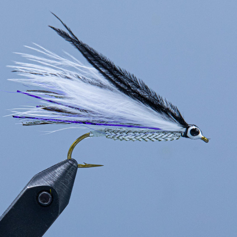 Winnipesaukee Smelt fishing fly with peacock and purple to imitate smelt tied for a Maine Fly Shop