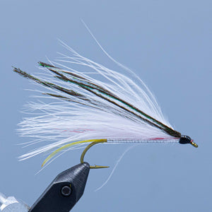 A white marabou and peacock streamer called the Ballou Special tied for a Rangeley Maine Fly Shop