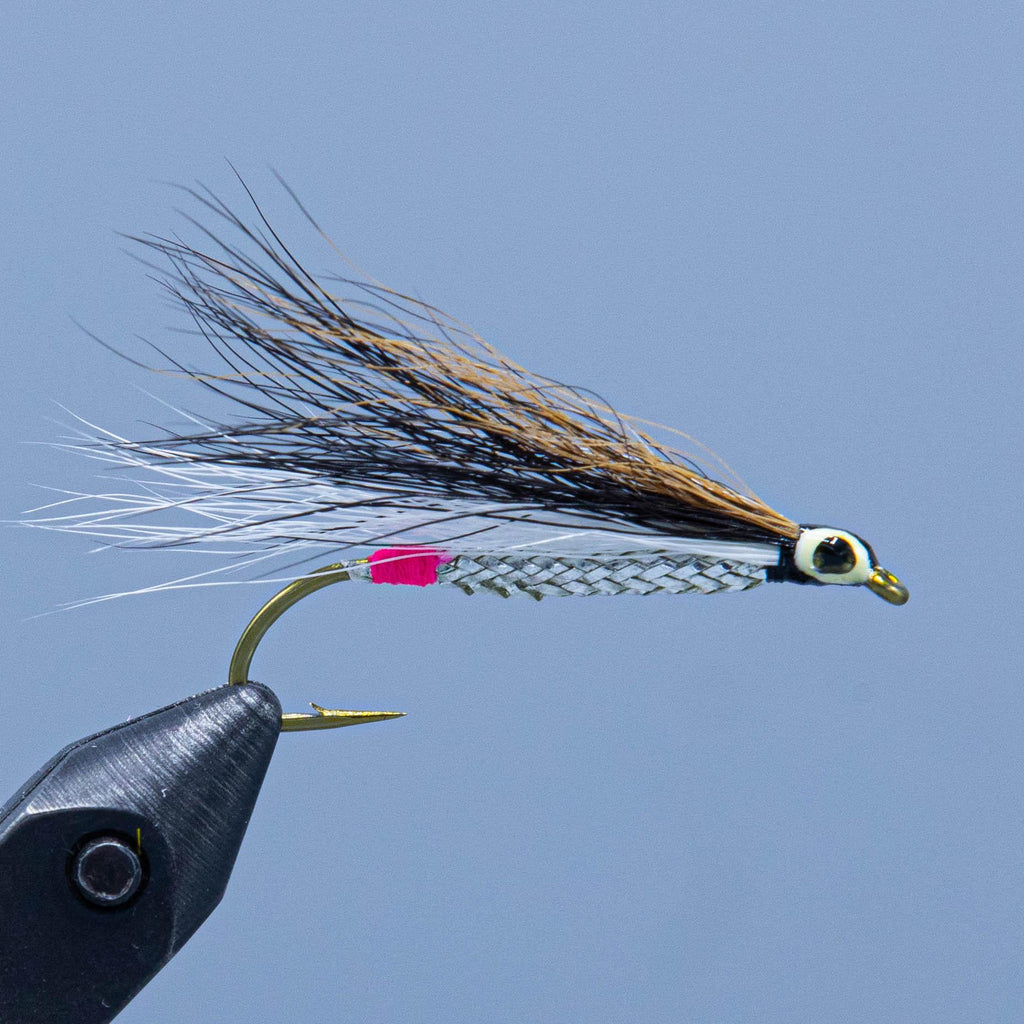 Brown, black, white, and silver streamer fishing fly tied for a Maine Fly Shop