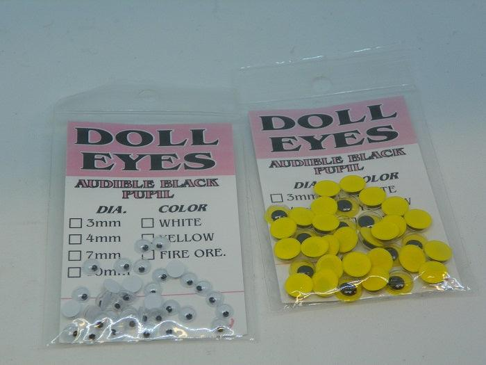 packages of doll eyes in yellow and white to be used in tying fishing flies
