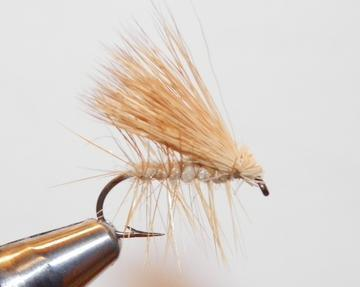 a tan deer hair caddis fishing fly from a Maine Fly Shop