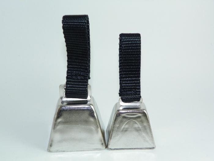two sizes of nickel plated cowbells for dogs used in hunting upland birds