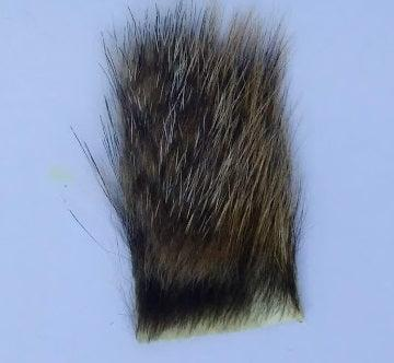 a small patch of woodchuck fur used in fly tying  - frequently used in tying the Ausable Wulff