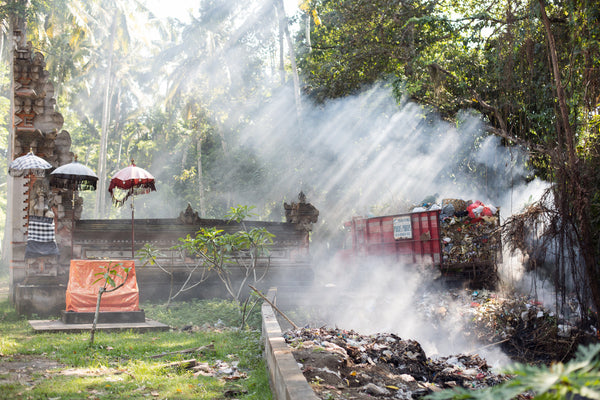 Trash burning next to Bali temple